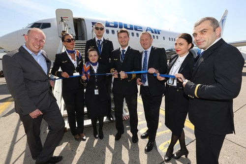 LJLA's CEO Andrew Cornish and Paul Winfield, Air Service Development Manager, celebrate the inaugural Liverpool to Cluj route whilst Blue Air Captain Popa Rares cuts the ribbon