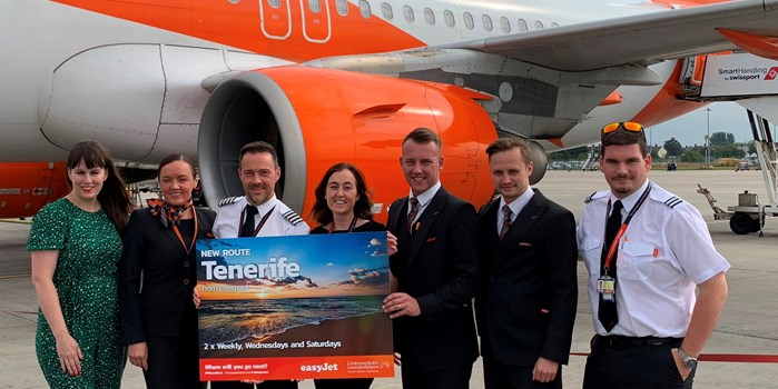 09 July 2019 - LJLA's Head of Marketing Katie Elliott (far left) joins easyJet cabin crew to celebrate the airline's new Tenerife service from Liverpool.